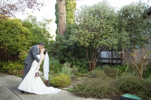 Bride and groom kiss after small wedding ceremony in Sacramento