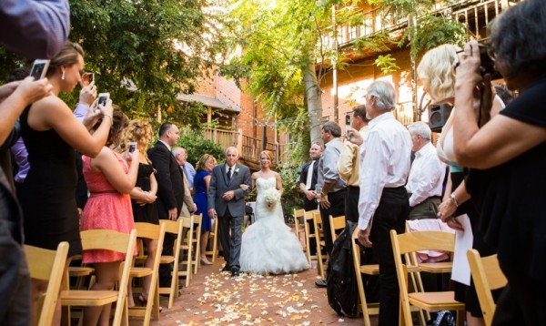 Bride walked down the aisle by her father at small Sacramento wedding