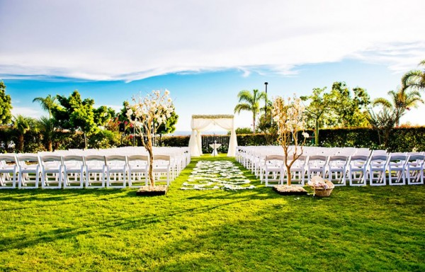Picturesque San Diego wedding venue with palm trees and flower petals