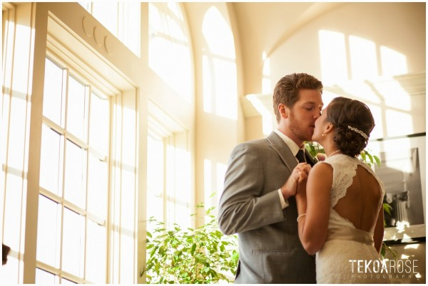 Newly weds kiss at the Brickstone Ballroom wedding venue in Vancouver, WA
