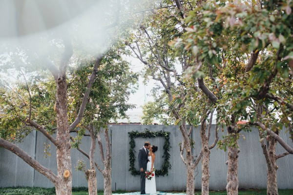 Newly weds pose at urban-chic wedding venue